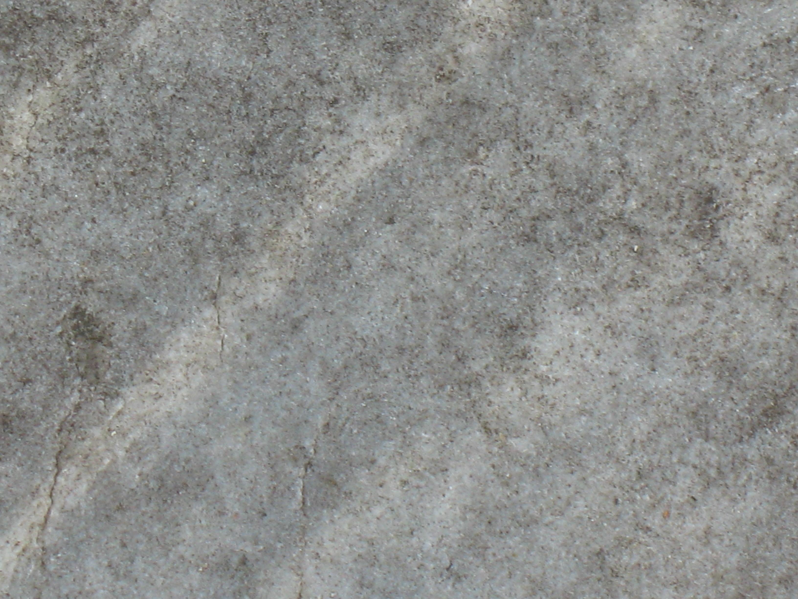 Огрубление поверхности и трещины на сером мраморе